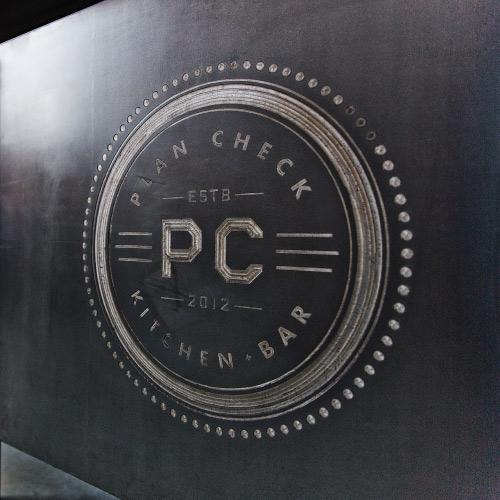 Image of Plan Check Kitchen + Bar Logo